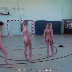 Three naked losers after a game in the gym.