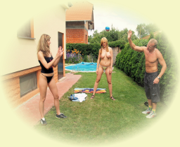 Two sexy girls losing a strip game out in the garden